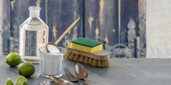 Eco friendly cleaning items with a rustic background.