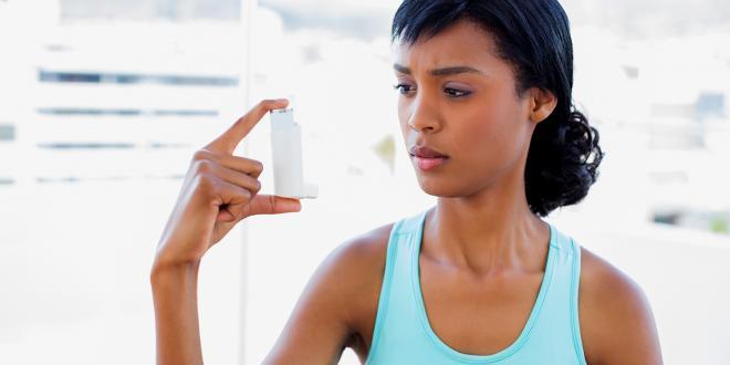 A woman wondering about her asthma inhaler